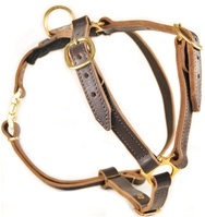 Handcrafted Leather Dog Harness. High quality Leather and Nylon dog harness, dog leashes, dog collars, dog muzzles and training equipment.